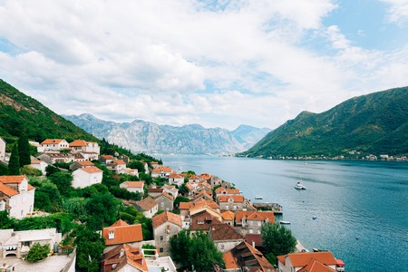 Perast view from the tower. Photos from the height, from the chapel of the church. Kotor Bay, Montenegro. Stock Photo