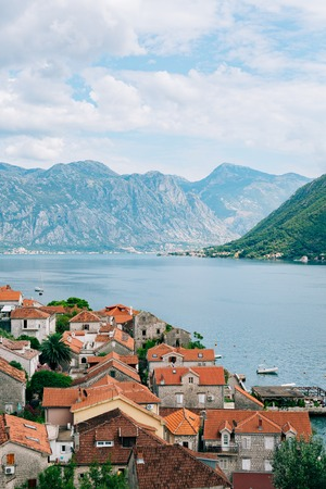 Perast view from the tower. Photos from the height, from the chapel of the church. Kotor Bay, Montenegro. Stock Photo - 85625083