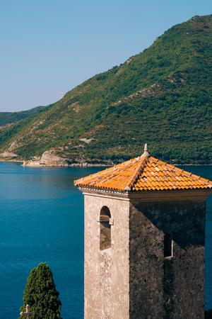 The old town of Perast on the shore of Kotor Bay, Montenegro. The ancient architecture of the Adriatic and the Balkans. Fishermens cities of Europe.