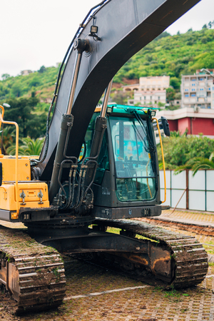 Excavator at a construction site. Building a house in Montenegro, Budva. Stock Photo