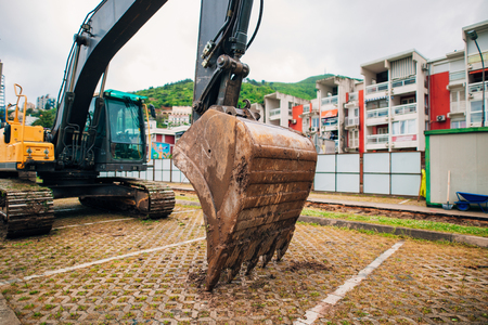 sand quarry: Excavator at a construction site. Building a house in Montenegro, Budva. Stock Photo
