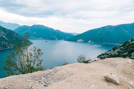 The island of Gospa od Skrpela, Kotor Bay, Montenegro. View from the high mountain above Risan. Stock Photo