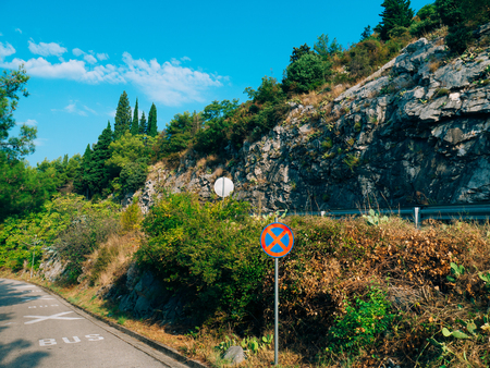 Road sign No Stopping . Nature in Montenegro Stock Photo