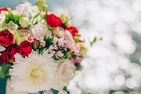 Bridal bouquet of roses and chrysanthemums on a background texture of water. Bay of Kotor, Montenegro.