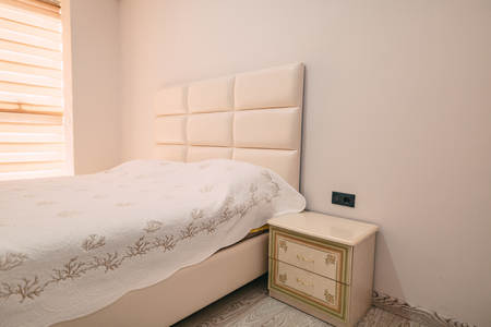 bedroom design: Bedside table in the bedroom next to the bed. Stock Photo