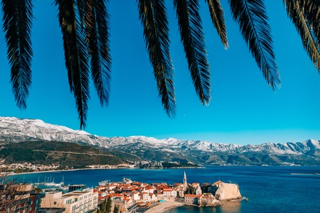 The Old Town of Budva, mountains covered with snow, Montenegro Stock Photo - 85874811