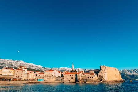 The Old Town of Budva, mountains covered with snow, Montenegro Stock Photo
