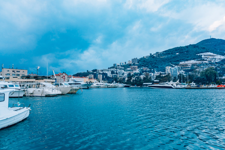 Luxury yachts on the coast in winter season. Marina in Budva, Montenegro Stock Photo