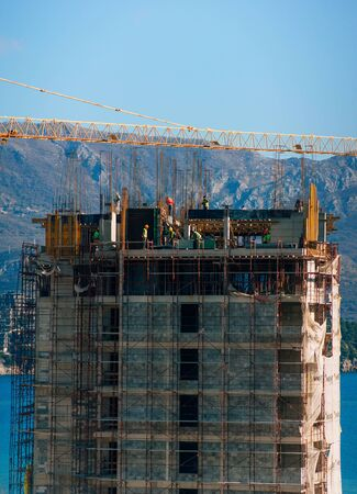 Construction of a multi-storey building. The crane is working. Budva, Montenegro.