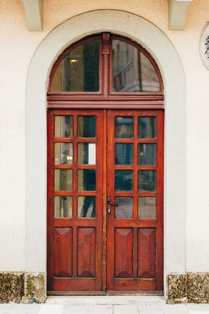 metal structure: Old yellow, brown, red doors. Wood texture. Old shabby irradiated paint