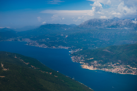 window view: Montenegrin coast, view from the airplane. Aerial shooting
