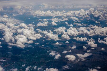 window view: White velvet clouds in the sky, view from the airplane. Stock Photo