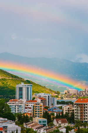 Rainbow over the city of Budva in Montenegro. Stock Photo