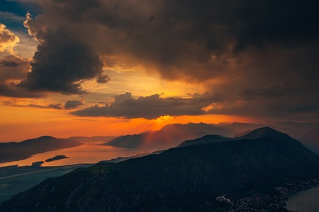 Sunset in Montenegro over the mountains and the sea. Orange sunsets. Фото со стока - 87578052