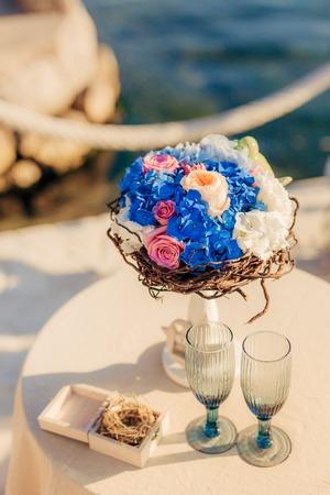 blue background: A wedding bouquet near the sea. Wedding in Montenegro.