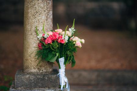 Wedding bouquet on a stone background. Wedding in Montenegro