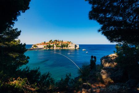 Silhouettes of couples near Sveti Stefan island in Montenegro