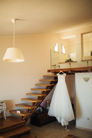 The brides dress on a hanger in the room in Montenegro