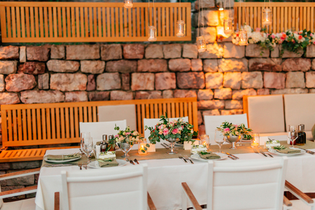 Wedding table in a rustic style with olives. Wedding in Montenegro