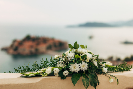 Flower compositions at the wedding ceremony. Wedding in Montenegro by the sea. Stock Photo