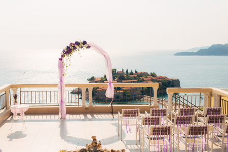 Arch for the wedding ceremony on the sea Фото со стока