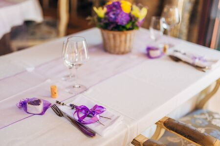 Wedding Table Setting At A Banquet. A Plate And Instruments Tied ...