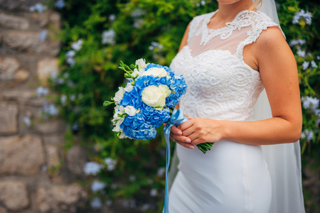 Wedding bouquet in hands of the bride. Wedding in Montenegro