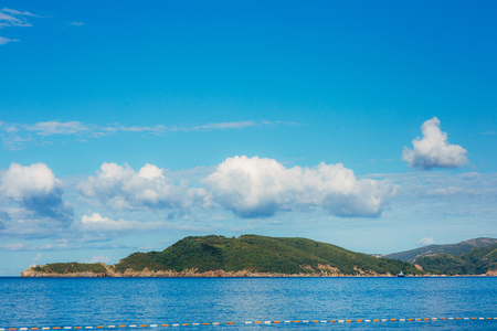 blue background: The island of St. Nicholas in Montenegro