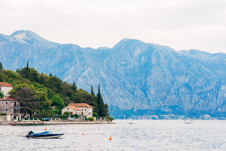 The old fishing town of Perast on the shore of Kotor Bay in Montenegro. Фото со стока - 87578060