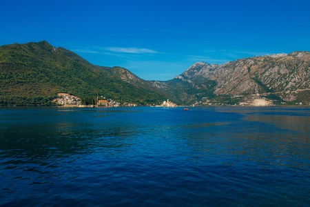 The island of Gospa od Skrpela in the Boko-Kotorsky Gulf near the town of Perast in Montenegro. Фото со стока - 87578062