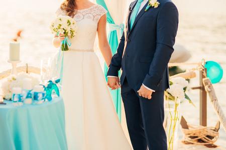 Bride and groom holding hands. Wedding in Montenegro