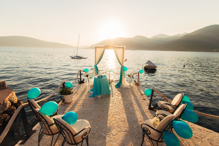 Arch for the wedding ceremony on the sea Stock Photo