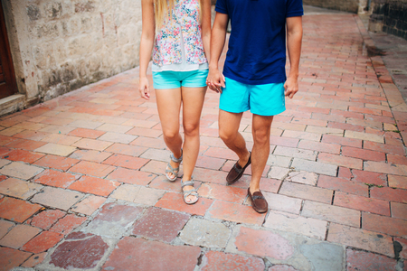 Female and male feet on the pavement. Wedding in Montenegro Фото со стока - 87128623