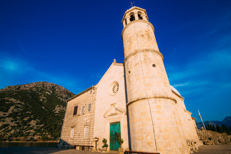 The island of Gospa od Skrpela in the Boko-Kotorsky Gulf near the town of Perast in Montenegro. Фото со стока - 87128631