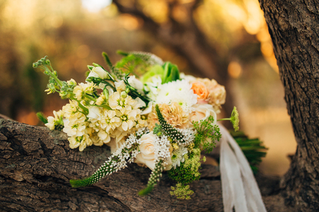 Wedding bouquet on a wooden background. Wedding in Montenegro Фото со стока