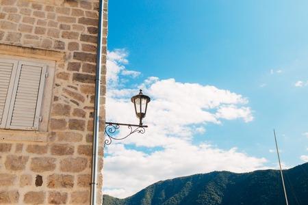 old photo: Street retro lantern on the streets of Montenegro. Stock Photo