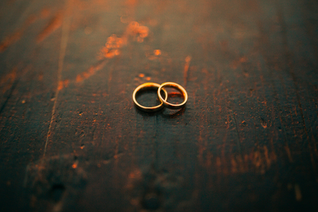 objects: Wedding rings on a textured background. Wedding in Montenegro