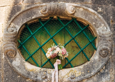 Wedding bouquet on textural background. Wedding in Montenegro Фото со стока - 87474372