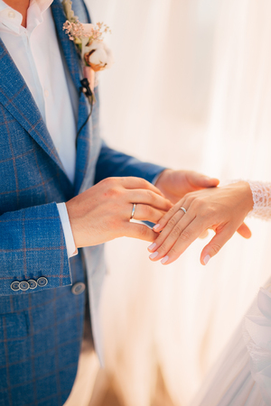 fingers put together: The newlyweds exchange rings at a wedding in Montenegro.