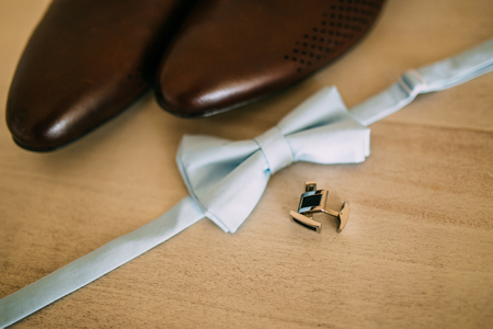 leather texture: Wedding accessories of the groom - a bow tie and brown shoes. Stock Photo