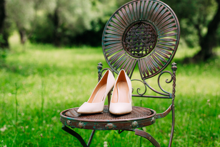 Brides shoes on a metal chair vintage
