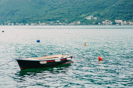 Wooden boats on the water. In the Bay of Kotor in Montenegro. Marine boats. Фото со стока