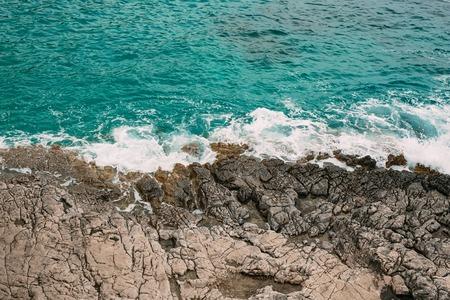 Rocks on the sea in Montenegro. Rocky coast. Wild beach. Dangerous coast. Фото со стока