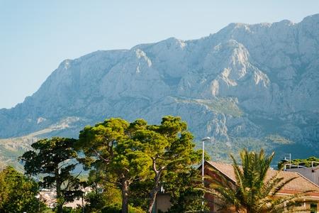 Mountain Komovi in Montenegro. Fog is falling on mountain as sun goes down. Nice as desktop background. Stock Photo
