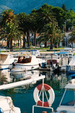 Wooden boats and fishing boats in Makarska, Croatia. Фото со стока