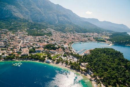Aerial Photo drone Makarska, Croatia. Coast city, sea and mountains 스톡 콘텐츠