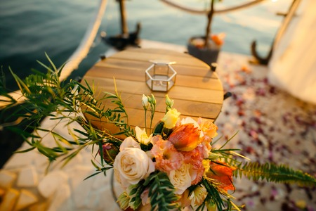 Table for the wedding ceremony, flower arrangement. Wedding decorations. Wedding at the sea in Montenegro.