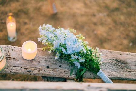 Wedding bridal bouquet of blue Delphinium on an old wooden bench handmade. Wedding in Montenegro, Adriatic. Фото со стока