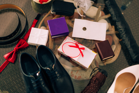 leather texture: Chaos on the table. Wedding attributes: shoes, rings, belt and other small things. Stock Photo