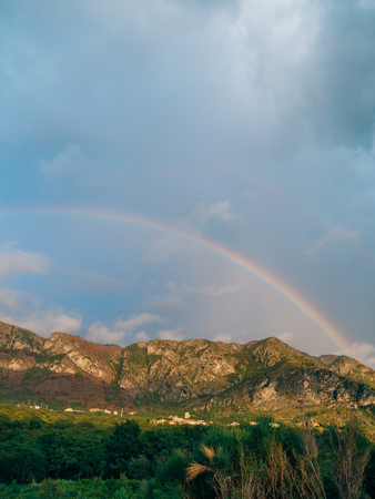 Double rainbow over the mountains. Montenegrin Mountains, the Balkans. Banco de Imagens - 86102442
